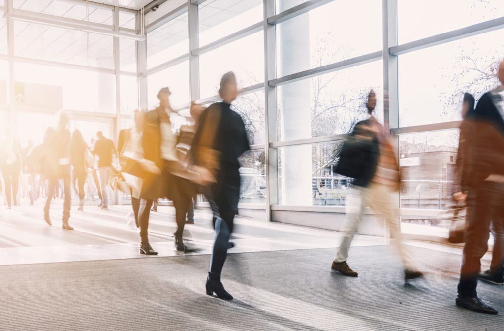 A group of blurred business people walking through a building